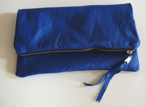 Make an easy lined leather clutch purse. .  Free tutorial with pictures on how to make a leather clutch in under 60 minutes by sewing with scissors, thread, and sewing machine. How To posted by Rachel J. Difficulty: Easy. Cost: Cheap. Steps: 11