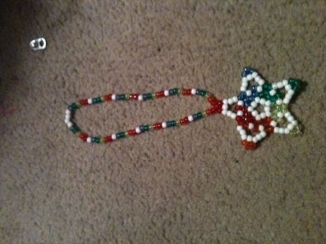 Rainbow Complex Star .  Make a woven bead necklace in under 31 minutes by beading with pony beads. Creation posted by XxHello-KittixX. Difficulty: Easy. Cost: Cheap.