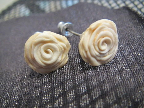 Pretty white rose studs made out of polymer clay .  Make a pair of clay earring in under 40 minutes by beading, gardening, jewelrymaking, molding, potting, decorating, and  with paint, polymer clay, and polymer clay glaze. Inspired by valentine's day, flowers, and flowers. Creation posted by Christina Y. Difficulty: 3/5. Cost: Cheap.