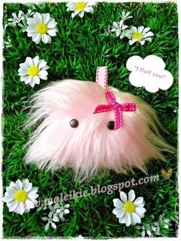 To spread some fluffyness in the world  .  Make a charm / keyring in under 40 minutes by needleworking and sewing with lace, faux fur, and brads. Inspired by monsters and kawaii. Creation posted by Maleikie .. Difficulty: Easy. Cost: Cheap.