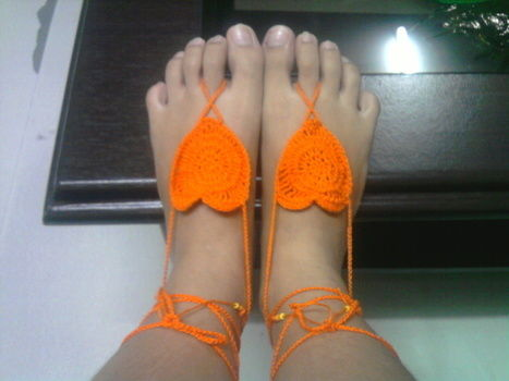 .  Stitch a pair of knit or crochet slippers in under 90 minutes Version posted by KhristineCrochet. Difficulty: Easy. Cost: Cheap.
