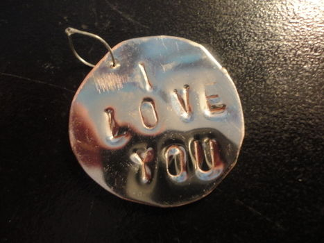 Cute metal pendant .  Stamp a stamped metal pendant in under 30 minutes by jewelrymaking with metal, punch, and dapping blocks. Creation posted by Sara. Difficulty: 4/5. Cost: 3/5.