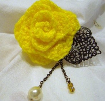 Ring around the roses.. .  Stitch a knit or crochet flower brooch in under 40 minutes by jewelrymaking and yarncrafting with yarn, fabric, and tulle. Inspired by flowers and clothes & accessories. Creation posted by gypsie_jay. Difficulty: Simple. Cost: Cheap.