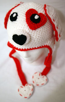 A cute puppy hat  .  Make an animal hat in under 120 minutes by crocheting with yarn, yarn needle, and liquid stitch. Inspired by valentine's day, dogs, and kawaii. Creation posted by Alecka. Difficulty: 4/5. Cost: Cheap.