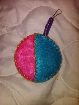 Quick and easy place to stash your ear buds. .  Sew a fabric circle pouch in under 30 minutes by embellishing and sewing with beads, key ring, and can tabs. Inspired by flowers and clothes & accessories. Creation posted by Michelle Ames. Difficulty: Easy. Cost: Absolutley free.