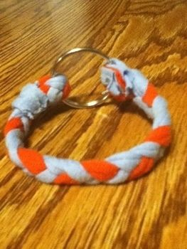 Adorable Recycled Bracelet! .  Make a braided fabric bracelet in under 23 minutes by sewing with t shirt, needle and thread, and key ring. Inspired by clothes & accessories. Creation posted by :). Difficulty: Easy. Cost: No cost.