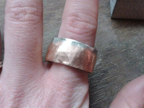 A ring for a dollar! .  Make a metal ring by jewelrymaking and metalworking with sand paper, hammer, and metal file. Inspired by valentine's day. Creation posted by aranumenwen. Difficulty: 3/5. Cost: No cost.