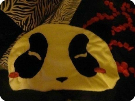 D.i.y. panda pillow .  Make a shaped cushion in under 98 minutes by knitting and sewing with scissors, thread, and thread. Inspired by pandas. Creation posted by A-mey-zing. Difficulty: Simple. Cost: Absolutley free.
