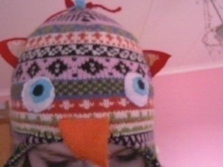 Really cute Owl cap! .  Free tutorial with pictures on how to make an animal hat in under 30 minutes by needleworking and sewing with fabric, scissors, and needle and thread. Inspired by birds, kawaii, and owls. How To posted by xYaelle. Difficulty: Easy. Cost: Absolutley free. Steps: 3