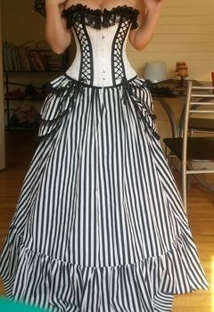 Skirt and bustle for a Victorian style costume .  Make a costume skirt by sewing with fabric and lace. Creation posted by Twyla S. Difficulty: 3/5. Cost: 3/5.