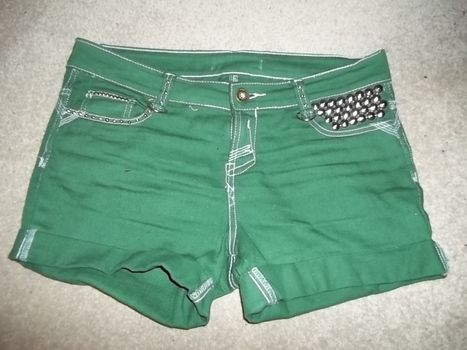 A pair of green studded shorts. .  Make shorts in under 150 minutes by embellishing and studding with jeans, studs, and dye. Creation posted by Eleanor. Difficulty: Easy. Cost: 3/5.