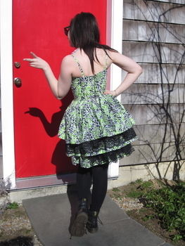 Neon Leopard Dress with lace bustle.  .  Sew a tiered dress by dressmaking with fabric, thread, and lace. Creation posted by Emily. Difficulty: Easy. Cost: 3/5.