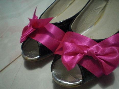 It's totally a throw away shoes,. .  Embellish a pair of ribbon shoes in under 30 minutes by creating and decorating with scissors, ribbon, and glue gun. Inspired by clothes & accessories. Creation posted by Erlyn G. Difficulty: Simple. Cost: Absolutley free.