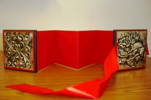 Love embossed heart accordion album .  Make an accordion photo frame in under 120 minutes by metalworking and paper folding with ribbon, ribbon, and paint. Inspired by valentine's day and hearts. Creation posted by artefact. Difficulty: Simple. Cost: Cheap.