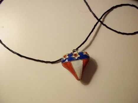 You're a grand old flag! .  Sculpt a clay shape necklace in under 20 minutes by jewelrymaking and  with pendant. Inspired by military, hearts, and hearts. Creation posted by Ashley P. Difficulty: Easy. Cost: Absolutley free.