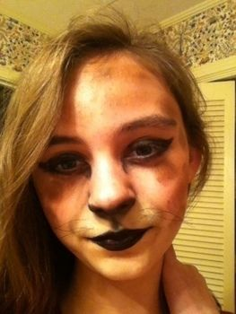 A very friendly feline..when she wants to be! .  Create a face painting in under 10 minutes by applying makeup, decorating, and applying makeup with thread, eyeshadow, and eyeshadow. Inspired by halloween, cats, and cats. Creation posted by Allie . Difficulty: Easy. Cost: Cheap.