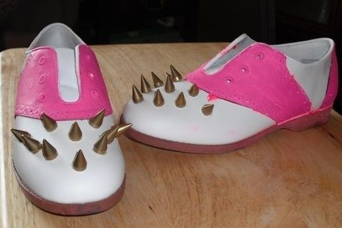 Painted shoes with golden cone spikes .  Make a pair of embellished shoes by studding with acrylic paint, paint brush, and super glue. Creation posted by Krafting Krampus. Difficulty: 3/5. Cost: 3/5.
