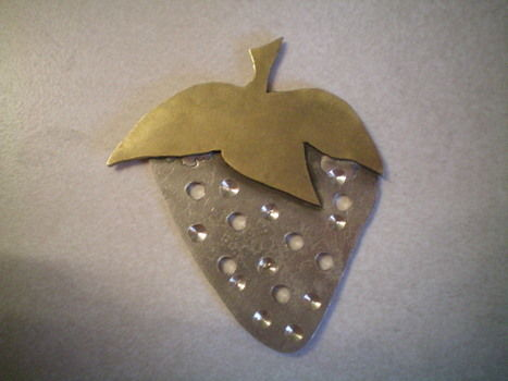 A strawberry and a duck  .  Create art / a model in under 60 minutes by constructing and metalworking with metal, saw, and torch. Creation posted by Aubrie S. Difficulty: Simple. Cost: No cost.