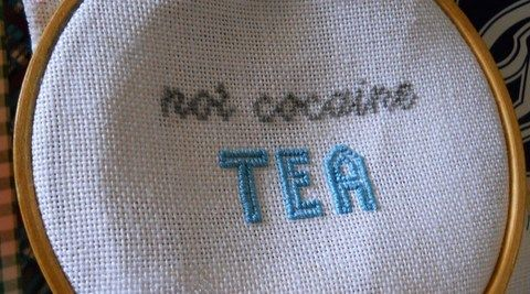 Inspired by my homegirl, Mrs Doyle of Father Ted, a little lettering project.  .  Cross Stitch art in under 60 minutes by cross stitching with embroidery floss, embroidery hoop, and crochet thread. Inspired by tea. Creation posted by Margo X. Difficulty: Easy. Cost: Cheap.