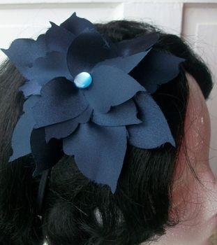 A Large Satin Bloom to Brighten Your Outfit .  Make a floral headband in under 60 minutes by hairstyling, decorating, jewelrymaking, and sewing with felt, buttons, and needle and thread. Inspired by crafts, vintage & retro, and flowers. Creation posted by Margo T.  in the Jewelry section Difficulty: Simple. Cost: 3/5.