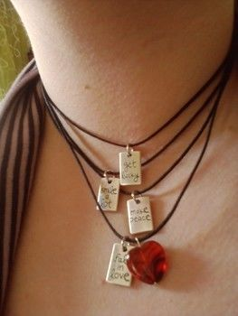 Think positive!!! .  Make a metal necklace in under 30 minutes by beading and jewelrymaking with beads and necklace cord. Inspired by valentine's day, gothic, and kawaii. Creation posted by joanna. Difficulty: Simple. Cost: 3/5.