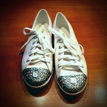 Classic tennis shoes dolled up in glitter and crystals .  Free tutorial with pictures on how to embellish a pair of sequin shoes in under 30 minutes by decorating with paint brush, super glue, and crystals. Inspired by miu miu and clothes & accessories. How To posted by Sallamari. Difficulty: Simple. Cost: Cheap. Steps: 1