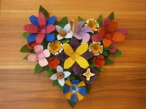 Don't throw that egg carton!!! .  Make a recycled wreath in under 120 minutes by decorating with scissors, acrylic paint, and hot glue gun. Inspired by flowers. Creation posted by Aleeza T. Difficulty: Easy. Cost: No cost.