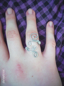 Swirly!! ;) .  Make a wire swirl ring in under 30 minutes by wireworking with beads, jewelry wire, and jewelry pliers. Inspired by clothes & accessories. Creation posted by Rachel W. Difficulty: Simple. Cost: Absolutley free.