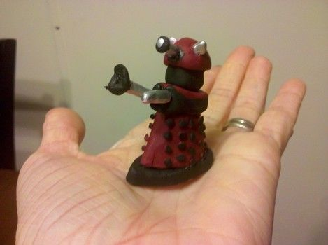 EXTERMINATE! .  Mold a clay character in under 30 minutes by baking, molding, and decorating with acrylic paint, polymer clay, and eye pins. Inspired by dr who and daleks. Creation posted by GryffindorGrl.  in the Decorating section Difficulty: Easy. Cost: Absolutley free.