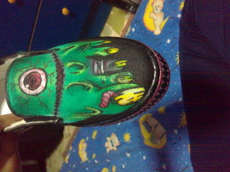 Everyone needs a pair of a living dead feet! .  Paint a pair of painted shoes by creating, drawing, spraypainting, and decorating with acrylic paint and canvas shoes. Inspired by halloween, zombies, and costumes & cosplay. Creation posted by Hikari Y. Difficulty: Simple. Cost: Cheap.