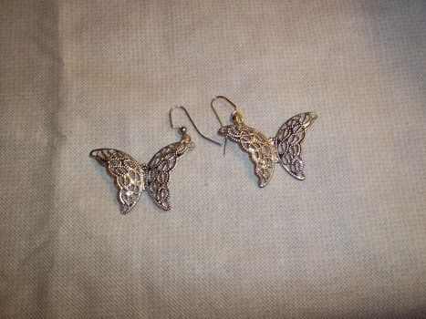 Put a spring in your style! .  Make a pair of pendant earrings in under 5 minutes by jewelrymaking and jewelrymaking with pendant(s). Inspired by creatures, butterflies, and butterflies. Creation posted by Ashley P. Difficulty: Easy. Cost: Absolutley free.