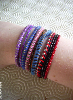 Simple and pretty! .  Braid a braided bead bracelet in under 10 minutes by jewelrymaking with embroidery thread, cord, and ball chain. Inspired by clothes & accessories. Creation posted by Rachel W. Difficulty: Easy. Cost: Cheap.