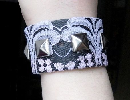 Studs + lace = <3 .  Free tutorial with pictures on how to make a cuff in under 20 minutes by decorating, studding, jewelrymaking, and studding with ribbon, hot glue gun, and lace. Inspired by gothic, vintage & retro, and clothes & accessories. How To posted by Anna H. Difficulty: Easy. Cost: No cost. Steps: 5