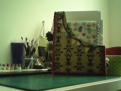 If you need a place to keep any loose pieces of paper hanging around your desk this is the project for you!! .  Free tutorial with pictures on how to make a box in under 60 minutes by decorating with fabric, wrapping paper, and cereal box. How To posted by Ellesdot. Difficulty: Easy. Cost: Absolutley free. Steps: 3