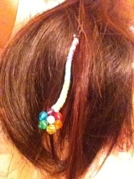 Flowers in your hair, but without the wilting! .  Make a beaded flower hair clip in under 10 minutes by beading and hairstyling with thread and beads. Inspired by flowers and rainbow. Creation posted by Wednesday Faye. Difficulty: Easy. Cost: Absolutley free.