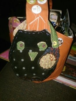 Fits my handbag perfectly---love it! .  Sew a fabric animal pouch in under 180 minutes by sewing with fabric, buttons, and suede. Inspired by creatures, vintage & retro, and clothes & accessories. Creation posted by Tame A. Difficulty: Simple. Cost: Absolutley free.
