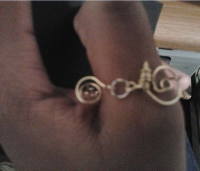 Inspired by Hugo^.^ .  Make a wire swirl ring by beading and wireworking with eye pins, round nose pliers, and o ring(s). Inspired by vintage & retro and clothes & accessories. Creation posted by Chyna W. Difficulty: Easy. Cost: Cheap.