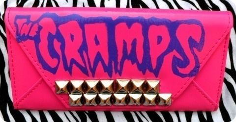 Stenciled and Studded .  Make a clutch in under 120 minutes by studding, stencilling, and studding with acrylic paint, studs, and sealant spray. Inspired by gothic, monsters, and kawaii. Creation posted by Sarah Atom. Difficulty: 3/5. Cost: No cost.