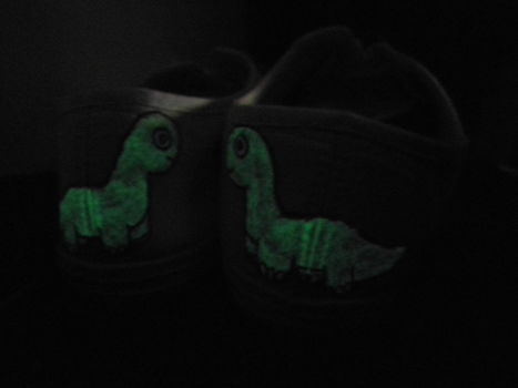 My painted glow in the dark dinosaur shoes for my friend :) .  Make a shoe in under 120 minutes by drawing and decorating with fabric paint, shoes, and fabric marker. Inspired by dinosaurs. Creation posted by Toni F. Difficulty: Easy. Cost: Cheap.