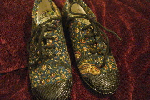 Fabric stitched on to regular canvas shoes .  Make a pair of fabric covered shoes in under 180 minutes by sewing with fabric, needle & thread, and fabric glue. Inspired by indian and clothes & accessories. Creation posted by Ambika K. Difficulty: Easy. Cost: Cheap.