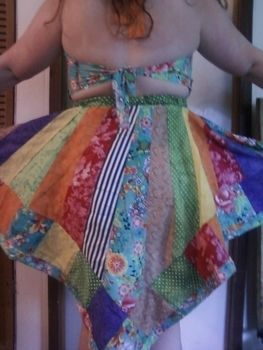 A patchwork dress .  Sew a patchwork dress by sewing and patchworking with fabric, thread, and elastic. Inspired by clothes & accessories. Creation posted by PollyB. Difficulty: 4/5. Cost: Cheap.