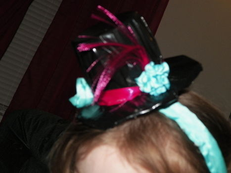 Very easy and very cheap!  .  Make a top hat in under 20 minutes by constructing and decorating with cardboard, hair band, and decorations. Inspired by costumes & cosplay and the mad hatter. Creation posted by Biscuit. Difficulty: Simple. Cost: Absolutley free.