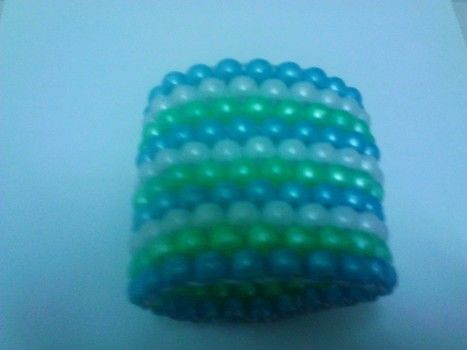 Simple and easy if you pratice .  Make a beaded cuff in under 50 minutes by beading and jewelrymaking with scissors, pony beads, and elastic thread. Inspired by clothes & accessories. Creation posted by Rocky.S. Difficulty: Simple. Cost: No cost.