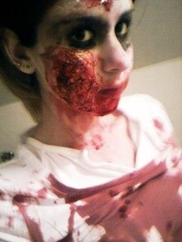Zombie flesh blood skin cheek dead ah halloween makeup  .  Create a face painting by creating, applying makeup, and applying makeup with paint brush, face paint, and tweezers. Inspired by halloween, zombies, and vampires. Creation posted by Kristen H. Difficulty: Simple. Cost: Cheap.