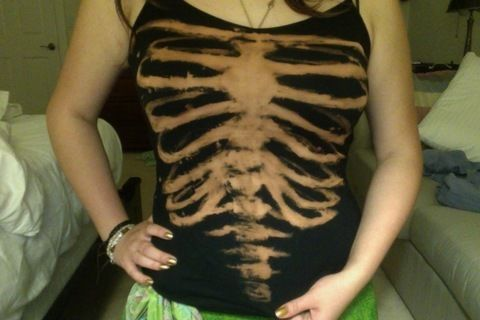 Simple, macabre, what's to lose? .  Free tutorial with pictures on how to make a decorated top in under 45 minutes by bleaching, not sewing, decorating, and bleaching with shirt, paintbrush, and bleach. Inspired by halloween, gothic, and skulls & skeletons. How To posted by Eve S. Difficulty: Easy. Cost: Absolutley free. Steps: 5