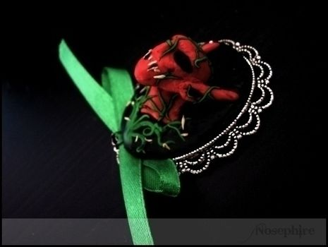 My Changeling & Nosferatu inspired Brooch .  Mold a clay brooch in under 90 minutes by molding with glue, satin ribbon, and fimo. Inspired by gothic, monsters, and nosferatu. Creation posted by Nosephire's Melancholy. Difficulty: Simple. Cost: Cheap.
