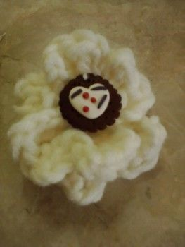 Chrochet flower brooches! .  Stitch a knit or crochet flower brooch in under 90 minutes by crocheting, amigurumi, and yarncrafting with yarn and crochet hook. Inspired by valentine's day, gothic, and vintage & retro. Creation posted by joanna. Difficulty: 3/5. Cost: Cheap.