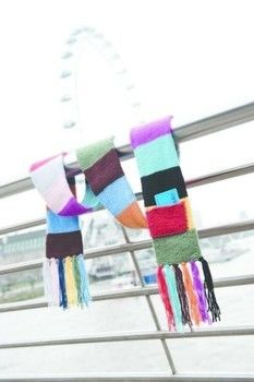 Knit a scarf in the colours of your favourite tube lines. .  Free tutorial with pictures on how to knit or crochet a stripy scarf in under 180 minutes by knitting with yarn, crochet hook, and cardboard. Inspired by london underground. How To posted by FW Media. Difficulty: 3/5. Cost: Cheap. Steps: 3