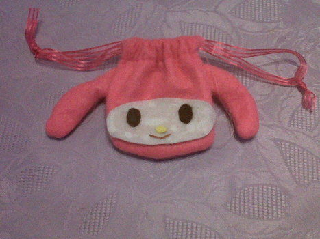 Sanrio character pouch .  Free tutorial with pictures on how to sew a fabric character pouch in under 40 minutes by needleworking, embroidering, needlepointing, and sewing with felt, ribbon, and glue. Inspired by hello kitty, kawaii, and sanrio. How To posted by Danielle. Difficulty: 3/5. Cost: No cost. Steps: 10