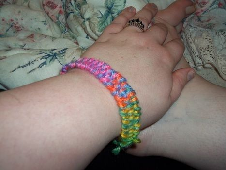 Pretty Bracelet Made of Simple Yarn .  Free tutorial with pictures on how to make a braided yarn bracelet in under 20 minutes by jewelrymaking, weaving, and yarncrafting with scissors, yarn, and coat hanger. Inspired by clothes & accessories. How To posted by Scarebear. Difficulty: Easy. Cost: Absolutley free. Steps: 15
